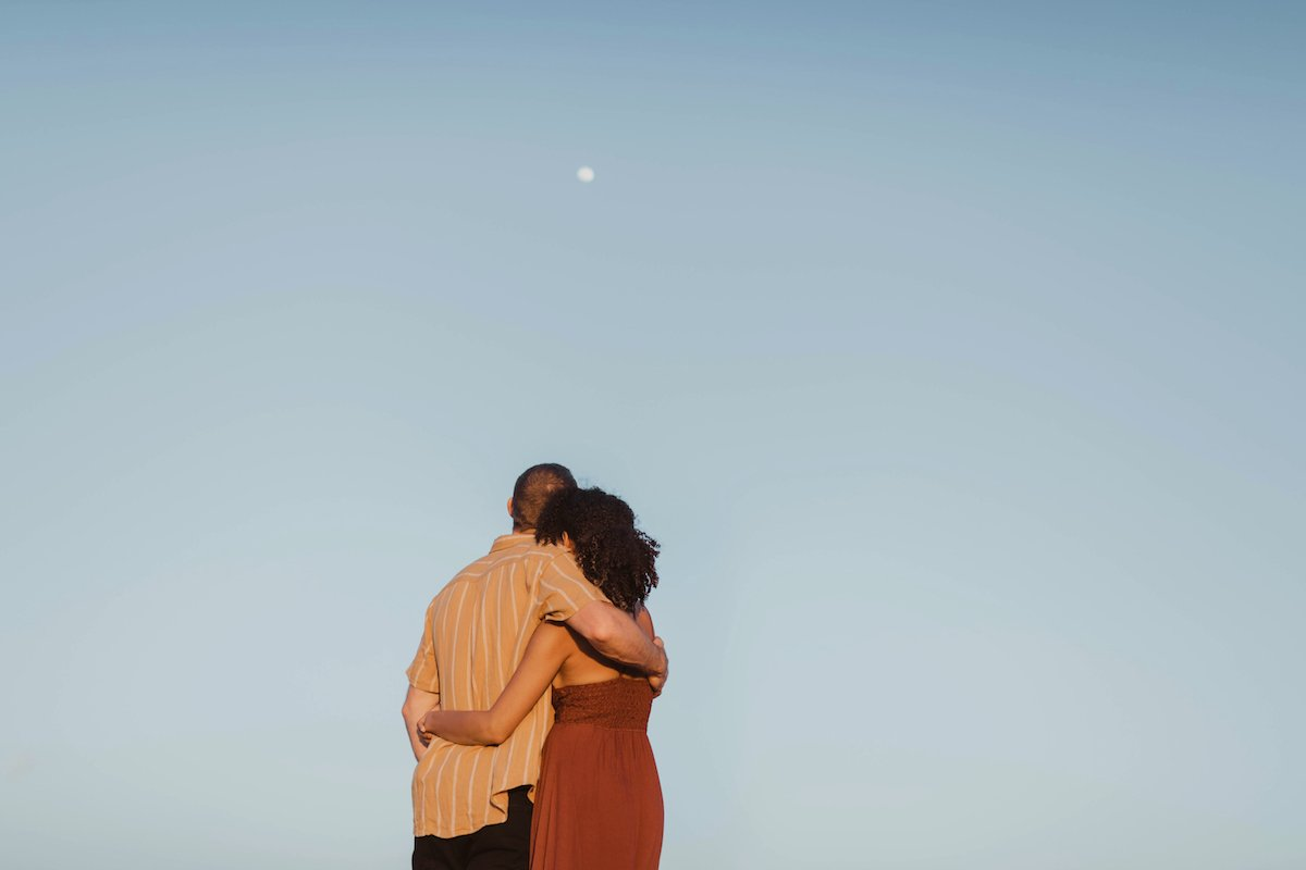 Image of couple looking at the moon
